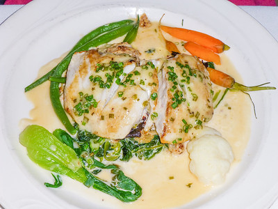 Seared Local Halibut with spinach and lemon beurre blanc at Hoppe's