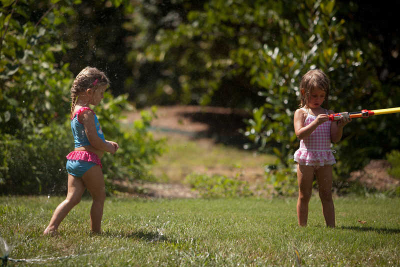 May and Julia wanted the sprinkler to cool down a little, an step out of the water battles.