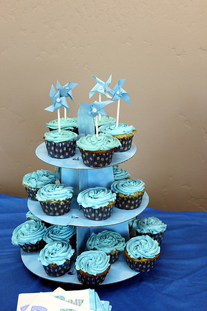 I made white cake cupcakes. Some with buttercream  & some with cream cheese frosting. I also made the pinwheels for the topper.