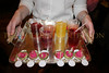 Health food: fresh juices and beet and goat cheese puree on endive