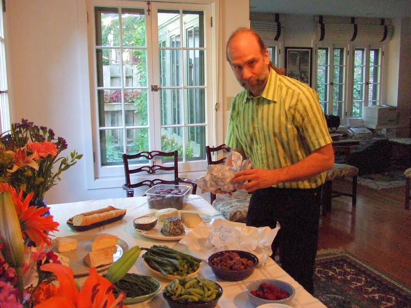 Bruce laying out food for the Friday night party at their home