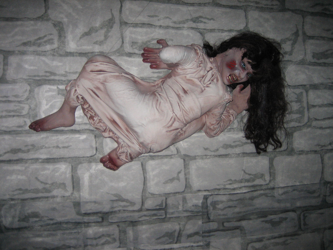exorcist girl on the wall
