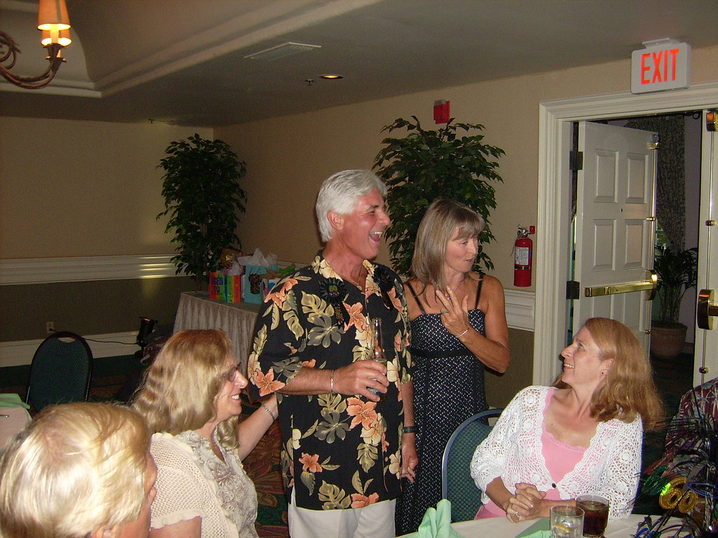 Kevin, Fran, Larry, Kathy and Kathy share a laugh at the party.