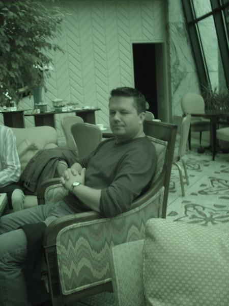 Matt pondering on more glass of champagne