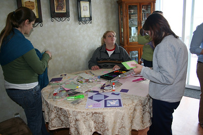 Working on scrap book pages for Mandy's shower.