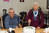 Marguerite Wabano cutting birthday beside Mushkegowuk Grand Chief Stan Louttit