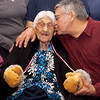 Danny Wabano kisses his mother, Marguerite Wabano, at her 105th birthday party