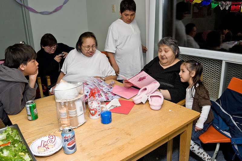 Mary Spence opening presents and cards at her 60th birthday party. Rita Edwards seated to her right.
