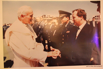 A poster sized photo displayed on an easel showing Sheriff Michael Hennessey meeting the pope.  ________________________EVENT FACTS: Sheriff Hennessey Retirement Party, Irish Cultural Center, 2700 45th Ave. San Francisco on December 2nd, 2011, 6-10pm.