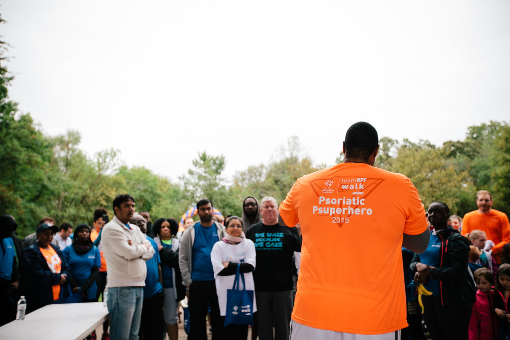 Jonathan Scott, NFL player and representative of the NPF's National Youth Ambassador program, speaks to the gathered crowd at the 2015 National Psoriasis Foundation Walk at River Legacy Park in Arlington, Texas.