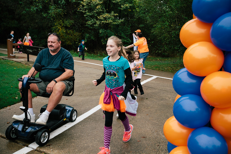 National Psoriasis Foundation Walk participants cross the finish line at River Legacy Park on November 7, 2015.