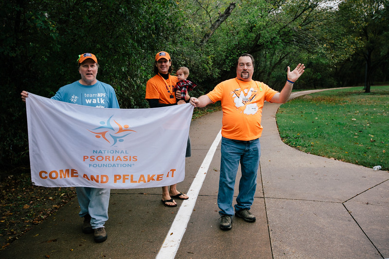 Matt Kiselica, Brian LaFoy, and Alan Simmons welcome walkers at the finish line of the 2015 NPF Walk.
