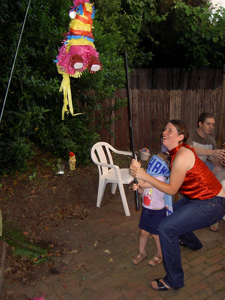 Lila goes for the pinata