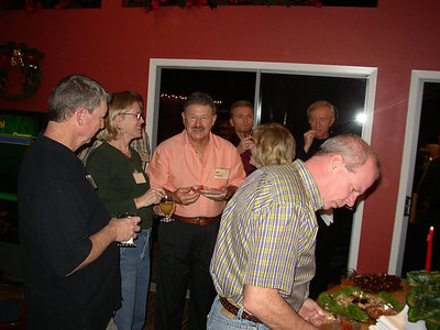 Paul and Barb Mabry with Joe and Jan Rougeau... and John Heckman serving himself!