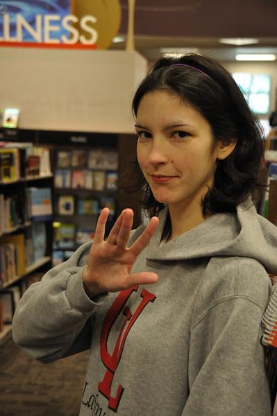 Rachael throws her gang sign.