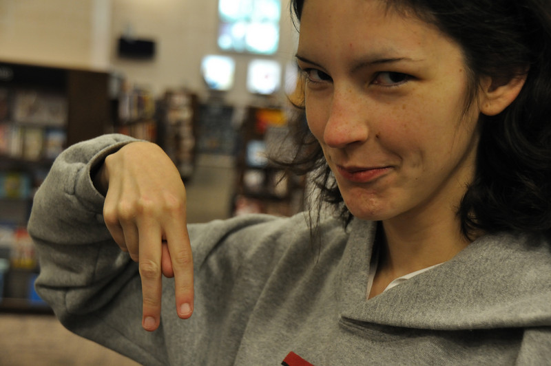 Rachael throws her other gang sign. She's very popular with organized criminals.