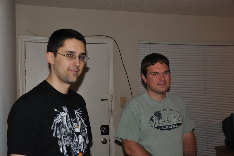Jude and Mitch stand as Greg takes a photograph.