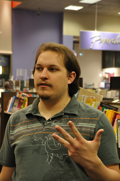 Chris is either throwing a gang sign he learned from Rachael or enumerating his talking points.