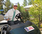 02 Aug 12 PGA Tour Official and former standout player Dillard Pruitt chases down a runaway dog during Thursdays First Round action at The Reno Tahoe Open at Montreaux Country Club in Reno, Nevada.