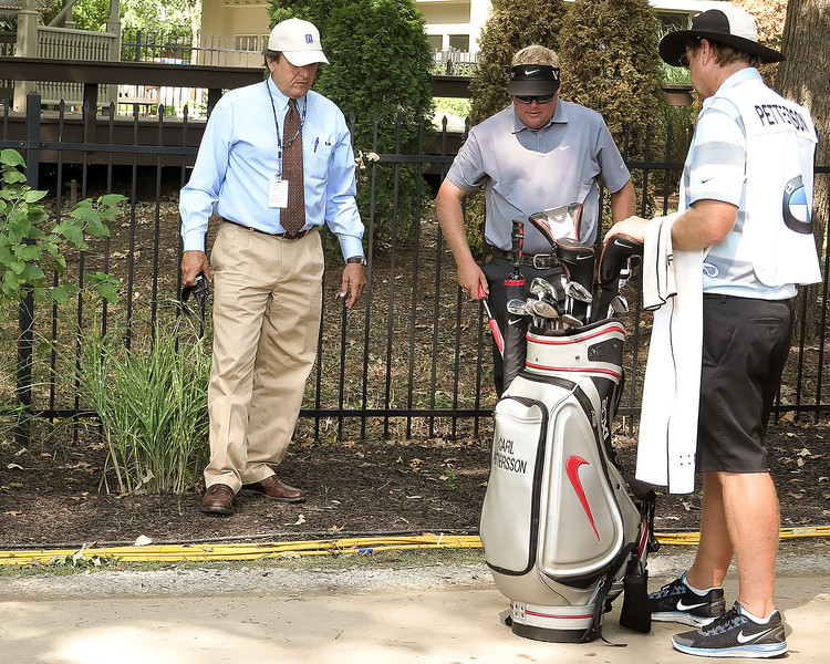 06 SEP 12 PGA Tour Official and former player Brad Fabel assists Carl Pettersson with a drop during Thursdays First Round of the The BMW Championship at The Crooked Stick Golf Club in Carmel, Indiana.