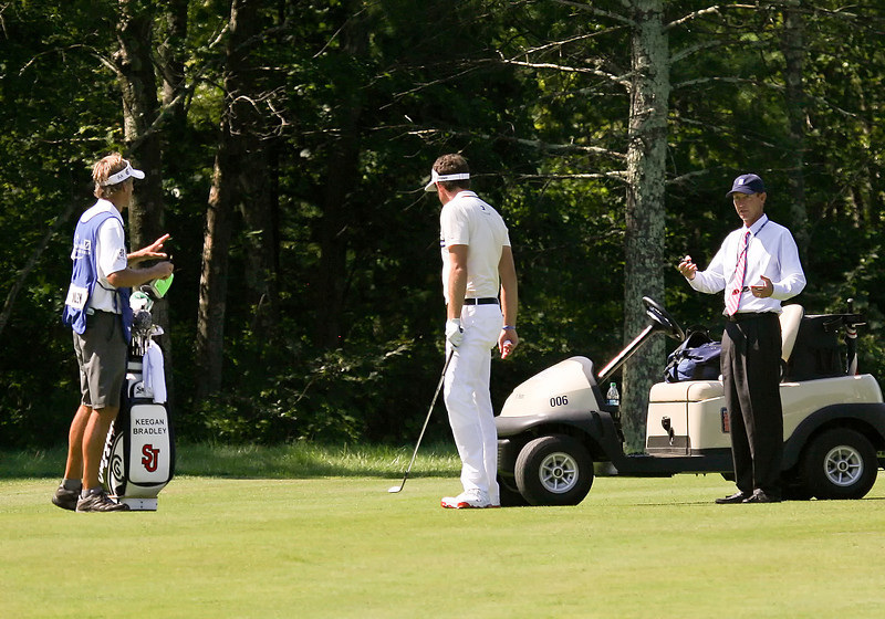 02 SEP 12  Keegan Bradley and caddie Steve Hale confer with official Robbie Ware during Sundays Third Round action at The Deutsche Bank Championship at The TPC of Boston in Norton, Massachusetts.