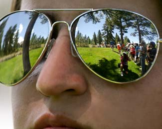 05 Aug 12  Reflections of John Daly on the 9th tee during Sundays Final Round action at The Reno Tahoe Open at Montreaux Country Club in Reno, Nevada.
