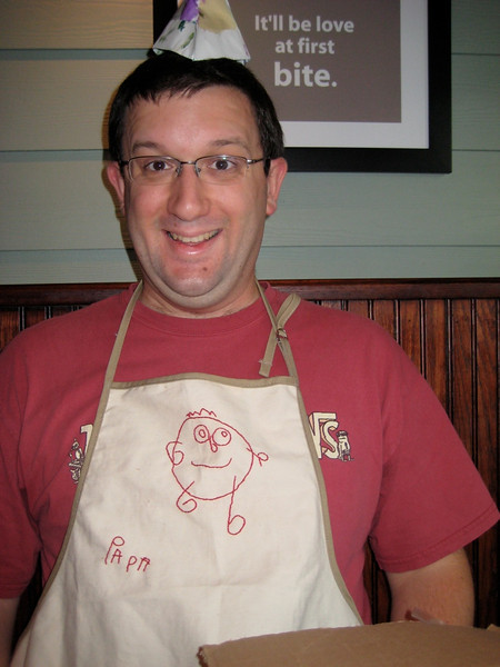 Modeling the new apron. Very snazzy!