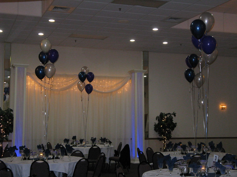 Prom Tables- Balloon Centerpieces in Silver, Navy Blue and Purple on Silver Balloon weights.  The balloons are high so everyone had a great view of the dance floor. <br /> Maneeley's in South Windsor, CT