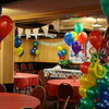 First Birthday Party- Multi-colored balloons with a personalized banner.  Balloon column has a giant 1 on the top.<br /> India Kitchen in Manchester