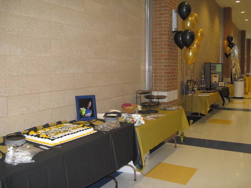 Softball Signing Ceremony- Black and Gold Table covers with Black and Gold Balloons for Bryant University livened up this very high space.<br /> Rockville High School Auditorium