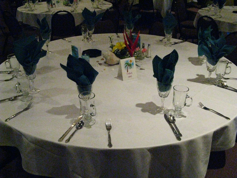 Luau-Conch Shell and Silk Floral Centerpiece with shells and battery operated votive candles.<br /> Maneeley's in South Windsor