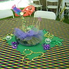Mardi Gras-Tulle base with Mask Centerpiece and battery votive candles.<br /> Tent Party in Madison, CT