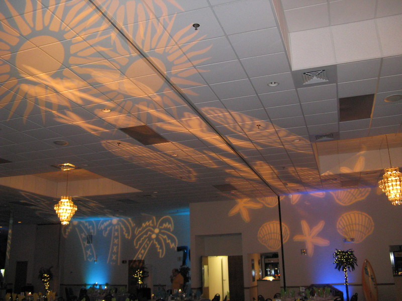 Beach Birthday Party- Another example of the lighting that was used all over the room.  The shells, sun and palm trees looked great with the lights down.  The uplighting in blue and teal was spectacular.  Lighting by Awesome Audio.<br /> Maneeley's in South Windsor