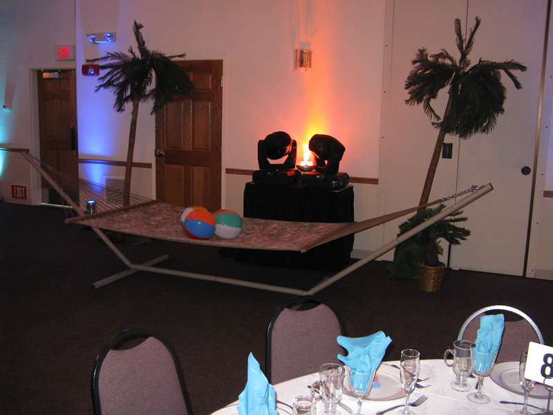 Beach Birthday Party- The guest of honor loves hammocks, so we set one up with palm trees and beach balls.  The lighting guys set up a console behind it for their ceiling lights. <br /> Maneeley's in South Windsor