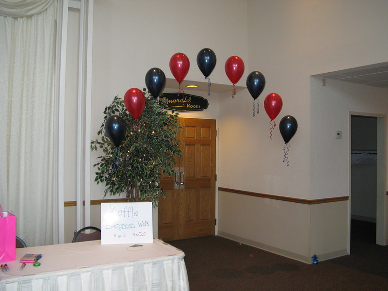 Fundraiser- String of Pearls navy blue and red balloon arches greeted guests as they entered the room.<br /> Maneeley's in South Windsor
