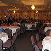 Football Banquet- Blue and Orange Balloon Bouquets with color-coordinated balloon weights.<br /> Maneeley's in South Windsor