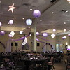 Purple Prom- The Moon and Stars theme is carried through the blue and purple hanging lanterns and silver stars with theme decor behind the DJ.  The string of pearls arches fill empty space.  The dance canopy is hung with purple tulle with a balloon center. <br /> Maneeley's in South Windsor, CT