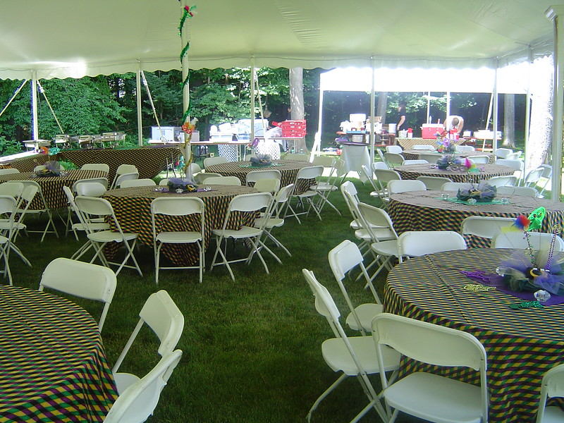 Mardi Gras- Decorated Tent Poles and Table Decor<br /> Tent Party in Madison, CT