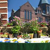 "Outdoor Display- Rockville Bank's ""Go Green"" promotion.  Maneeley's in South Windsor was the caterer.  They brought a farm wagon, covered it in green carpet, and arranged fresh vegetables, sandwiches, and cheese and crackers.  We arranged plants and baskets of fruit and vegetables to give a fresh, farmer's market look to the event.  We also put green and white balloons at various spots throughout the park. <br /> Evergreen Walk in South Windsor"