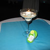 Beach Birthday Party- Each cabaret table had a margarita glass filled with sand and shells and a lit votive.  The adorable flip flops were favors for each guest.  There was a message thanking the guests for attending, but a picture could be substituted.<br /> Maneeley's in South Windsor