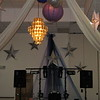 Prom Backdrop- Stars and Tulle behind the DJ next to the dance floor with hanging lanterns and dance canopy in the foreground.<br /> Maneeley's in South Windsor