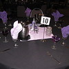 Purple Prom- The prom committee supplied the star centerpieces and I put the ribbon curls on them to carry the color theme.  The favors were purple gel candles in martini glasses.  The tablecovers were black with purple and lilac napkins. <br /> Maneeley's in South Windsor