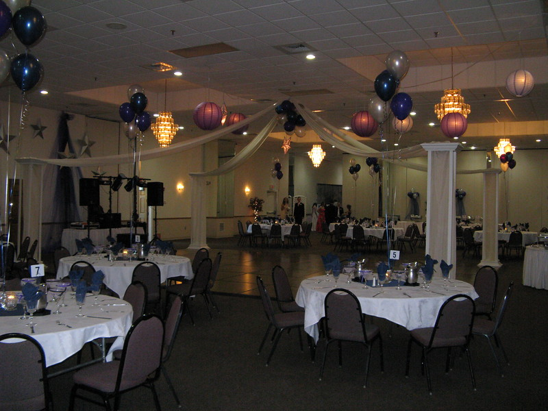 Here's to the Night Prom- Dance Floor with Purple and Blue lanterns and silver stars.  <br /> Maneeley's in South Windsor