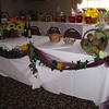 Under the Tuscan Sun- Fundraiser Dinner Dance for St. Bart's in Manchester.  This was the raffle prize area.  We decorated the table with sunflowers, grapes, and an artisanal bread basket.  Burgundy tulle carried the burgundy color throughout.  This could be used as head table decoration at a fall wedding.<br /> Georgina's in Bolton, CT