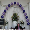 Purple Prom- The seating card table at the front entrance is decorated with a string of pearls balloon arch. The principal of the school looks happy to be at Prom!<br /> Maneeley's in South Windsor