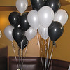 Black and White Wedding Shower- Black and White Balloons are arranged in an ivy bowl with black and white gems and silk roses.<br /> Vito's by the Park in Hartford