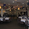 "Purple, Blue and Silver Prom-  The theme was ""Here's to the Night"".  We did balloon centerpieces, a dance floor with hanging lanterns, a backdrop behind the DJ, and a balloon arch in the foyer.  <br /> Maneeley's in South Windsor"