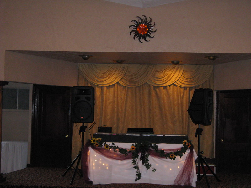 Under the Tuscan Sun - This was a dinner dance fundraiser.  We found this great sun and lit it from behind with battery operated lights.  The DJ table was decorated with burgundy tulle, grapevines and sunflowers.<br /> Georgina's in Bolton, CT