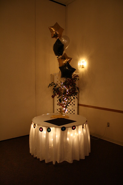 Adult Birthday Cake Table- Lighted decorated cake table with gold, silver and black balloons.  The cake hasn't arrived yet, but you get the idea. <br /> Maneeley's in South Windsor