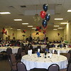 Fundraiser- Navy Blue and Red Balloon Centerpieces added some color to a large fundraiser.  We put balloons on every other table.  We ended up using about 75 balloons.  Could you carry 75 balloons in your car?  The organizers realized they couldn't carry all the balloons they needed, and they didn't have time to blow up all the balloons, so we came in and did it for less than it would cost at the Party Store!<br /> Maneeley's in South Windsor